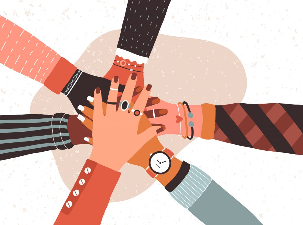 Hands,Of,Diverse,Group,Of,People,Putting,Hands,Together - Partnerships